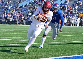 Oct 31, 2020; Lawrence, Kansas, USA; Iowa State Cyclones quarterback Brock Purdy (15) runs in for a touchdown as Kansas Jayhawks linebacker Steven Parker (14) chases during the first half at David Booth Kansas Memorial Stadium. Mandatory Credit: Denny Medley-USA TODAY Sports