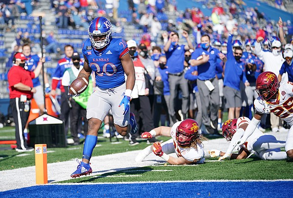 Oct 31, 2020; Lawrence, Kansas, USA; Kansas Jayhawks running back Daniel Hishaw Jr. (20) scores a touchdown as several Iowa State Cyclones players miss the tackle during the first half at David Booth Kansas Memorial Stadium. Mandatory Credit: Denny Medley-USA TODAY Sports