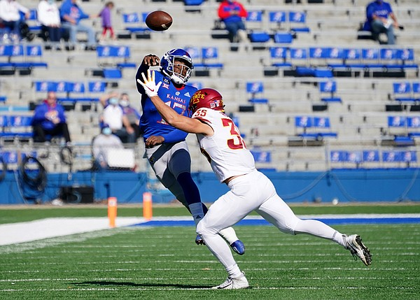 Oct 31, 2020; Lawrence, Kansas, USA; Kansas Jayhawks quarterback Jalon Daniels (17) throws a pass as Iowa State Cyclones linebacker Jake Hummel (35) attempts the tackle during the first half at David Booth Kansas Memorial Stadium. Mandatory Credit: Denny Medley-USA TODAY Sports