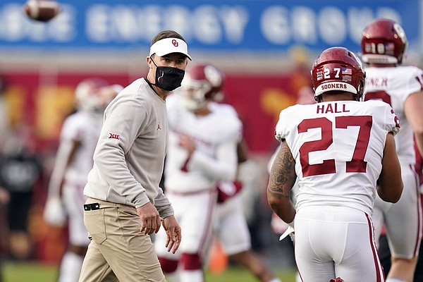 FILE - In this Saturday, Oct. 3, 2020, file photo, Oklahoma head coach Lincoln Riley watches his team warm up before an NCAA college football game against Iowa State in Ames, Iowa. The Big 12 made it to November with every team at least halfway through its reduced regular-season schedule, five-time defending conference champion Oklahoma finally on a roll, and the league probably already out of playoff contention. (AP Photo/Charlie Neibergall, File)