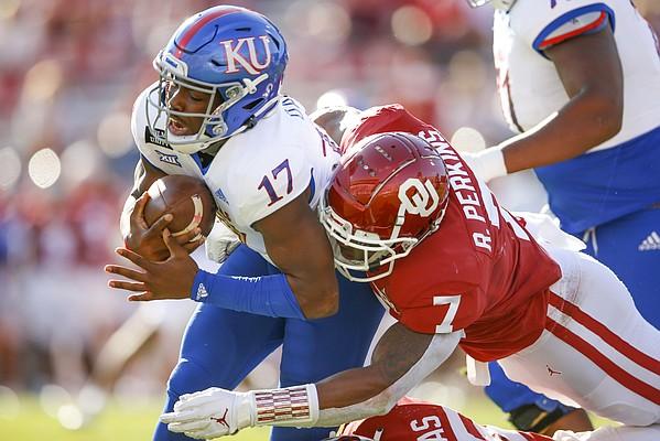 Oklahoma defensive end Ronnie Perkins (7) tackles Kansas quarterback Jalon Daniels (17) during an NCAA college football game in Norman, Okla., Saturday, Nov. 7, 2020. (Ian Maule/Tulsa World via AP)