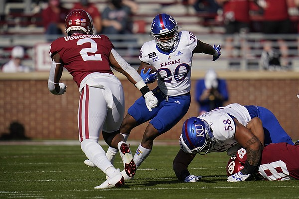 Kansas running back Daniel Hishaw Jr. (20) carries during an NCAA college football game against Oklahoma in Norman, Okla., Saturday, Nov. 7, 2020. (AP Photo/Sue Ogrocki)