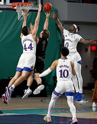 Kansas players Marcus Garrett and Mitch Lightfoot defend a shot during a game against Saint Joseph's on Friday Nov. 27, 2020. The Jayhawks earned a 94-72 win over the Hawks in the Rocket Mortgage Fort Myers Tip-Off at the Suncoast Credit Union Arena in Fort Myers, Florida.