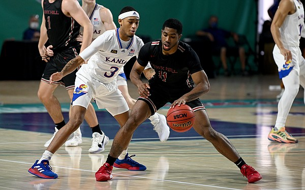 Kansas redshirt freshman Dajuan Harris defends the ball during a game against Saint Joseph's on Friday Nov. 27, 2020. The Jayhawks earned a 94-72 win over the Hawks in the Rocket Mortgage Fort Myers Tip-Off at the Suncoast Credit Union Arena in Fort Myers, Florida.