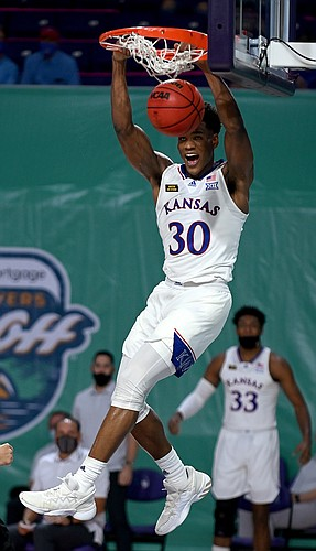 Kansas junior Ochai Agbaji finishes off a dunk during a game against Saint Joseph's on Friday Nov. 27, 2020. The Jayhawks earned a 94-72 win over the Hawks in the Rocket Mortgage Fort Myers Tip-Off at the Suncoast Credit Union Arena in Fort Myers, Florida.