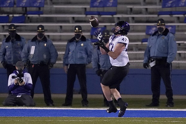 TCU tight end Carter Ware (47) catches a pass for a touchdown during the first half of an NCAA college football game against Kansas in Lawrence, Kan., Saturday, Nov. 28, 2020. (AP Photo/Orlin Wagner)