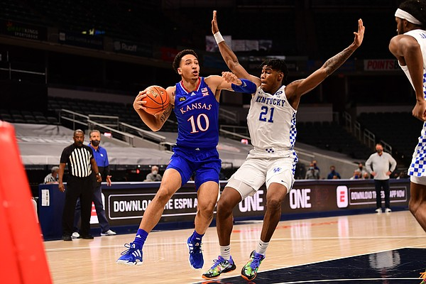 Kansas redshirt freshman Jalen Wilson drives past a Kentucky defender Tuesday night during the Champions Classic inside Bankers Life Fieldhouse in Indianapolis on Dec. 1, 2020. Photo courtesy of Phil Ellsworth of ESPN.