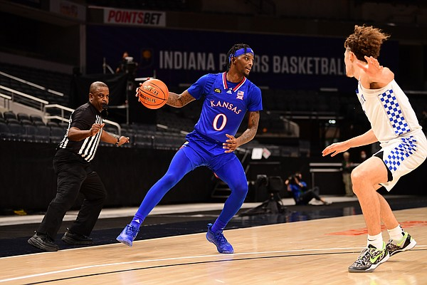 Kansas senior Marcus Garrett attempts to make a move past a Kentucky defender Tuesday night during the Champions Classic inside Bankers Life Fieldhouse in Indianapolis on Dec. 1, 2020. Photo courtesy of Phil Ellsworth of ESPN.