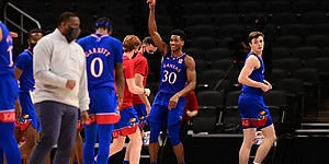 Kansas junior Ochai Agbaji celebrates a play in a game against Kentucky Tuesday night during the Champions Classic inside Bankers Life Fieldhouse in Indianapolis on Dec. 1, 2020. Photo courtesy of Phil Ellsworth of ESPN.