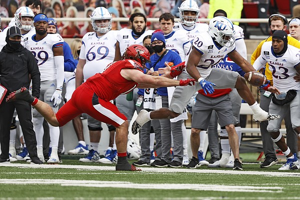 Texas Tech's Colin Schooler (17) pushes Kansas' Daniel Hishaw Jr. (20) out of bounds during the first half of an NCAA college football game Saturday, Dec. 5, 2020, in Lubbock, Texas. (AP Photo/Brad Tollefson)