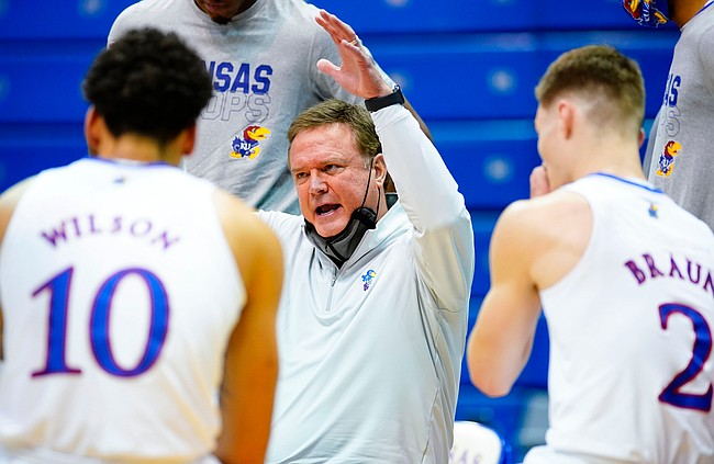 Kansas head coach Bill Self talks with his players in the huddle during the first half on Tuesday, Dec. 8, 2020 at Allen Fieldhouse.