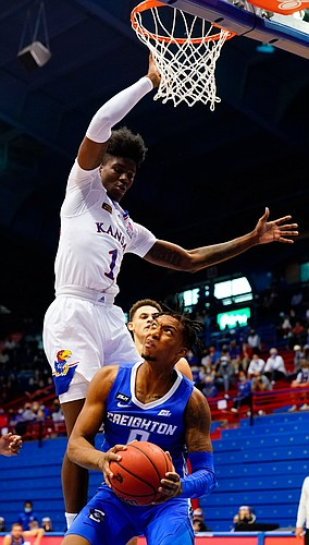 Kansas guard Tyon Grant-Foster (1) hangs over Creighton guard Antwann Jones (0) for a block during the first half on Tuesday, Dec. 8, 2020 at Allen Fieldhouse.