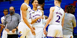 Kansas forward Jalen Wilson (10) and Kansas guard Christian Braun (2) share a moment following the Jayhawks' 73-72 win over Creighton on Tuesday, Dec. 8, 2020 at Allen Fieldhouse. The Jayhawks escaped with the win despite Braun missing the front end of a one-and-one and Wilson fouling Creighton guard Marcus Zegarowski (11) on a three-point shot with seconds remaining.