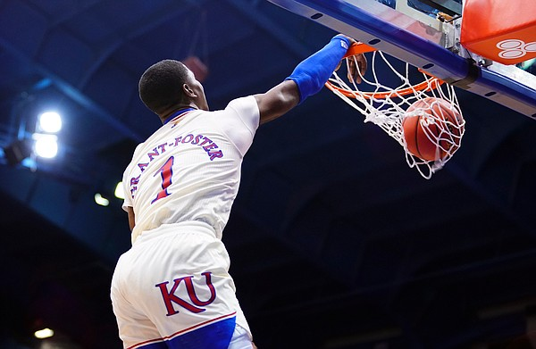 Kansas guard Tyon Grant-Foster (1) throws down a dunk during the second half on Friday, Dec. 11, 2020 at Allen Fieldhouse.