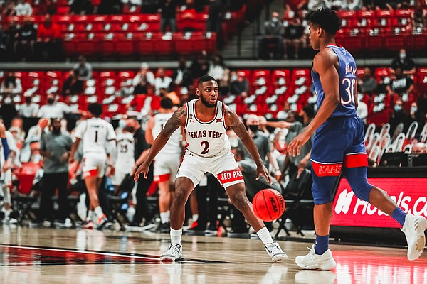 Kansas junior Ochai Agbaji dribbles the ball up the court during a game against Texas Tech Thursday night in the United Supermarkets Arena on Dec. 17, 2020. Photo courtesy of Texas Tech Athletics.