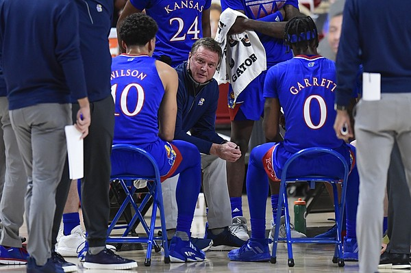 Kansas' head coach Bill Self talks to the team during in a timeout in the first half of an NCAA college basketball game against Texas Tech in Lubbock, Texas, Thursday, Dec. 17, 2020.