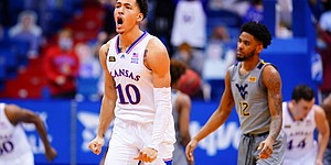 Kansas forward Jalen Wilson (10) roars after hitting a three pointer against West Virginia during the second half, Tuesday, Dec. 22, 2020 at Allen Fieldhouse.