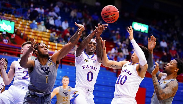 Kansas guard Marcus Garrett (0), West Virginia forward Derek Culver (1), Kansas forward Jalen Wilson (10) and West Virginia forward Gabe Osabuohien (3) compete for a loose ball during the second half, Tuesday, Dec. 22, 2020 at Allen Fieldhouse.