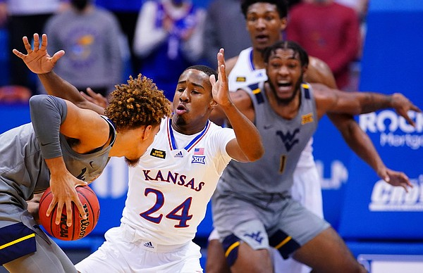 Kansas guard Bryce Thompson (24) hounds West Virginia forward Emmitt Matthews Jr. (11) during the first half, Tuesday, Dec. 22, 2020 at Allen Fieldhouse.