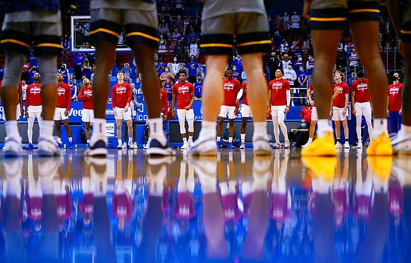 The Jayhawks and Mountaineers share a moment of silence prior to tipoff, Tuesday, Dec. 22, 2020 at Allen Fieldhouse.