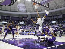 Kansas junior Ochai Agbaji falls to the floor during a game against TCU Tuesday night at Schollmaier Arena in Fort Worth, Texas on January 5, 2021. (Photo/Gregg Ellman)