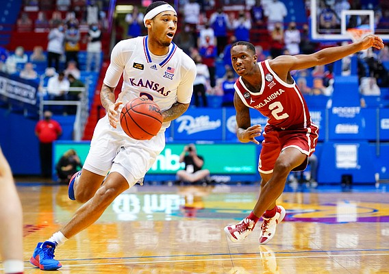 Kansas guard Dajuan Harris (3) drives to the bucket past Oklahoma guard Umoja Gibson (2) during the second half, Saturday, Jan. 9, 2021 at Allen Fieldhouse.