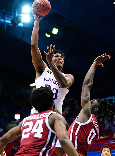 Kansas forward David McCormack (33) turns for a shot over Oklahoma forward Victor Iwuakor (0) during the second half, Saturday, Jan. 9, 2021 at Allen Fieldhouse.