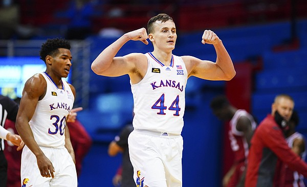Kansas forward Mitch Lightfoot (44) flexes after a bucket and an Oklahoma timeout during the first half, Saturday, Jan. 9, 2021 at Allen Fieldhouse.