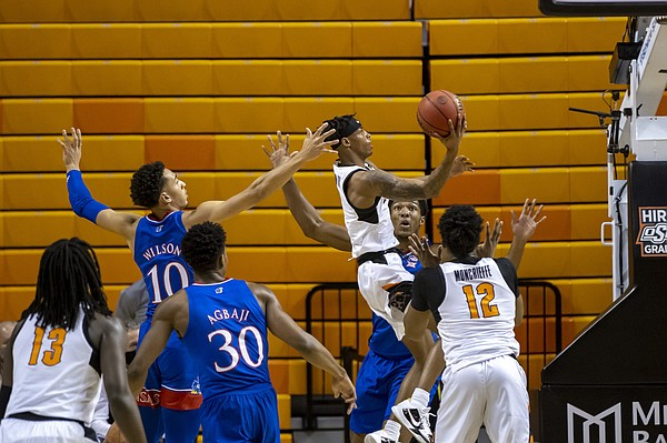 Oklahoma State's Avery Anderson III shoots a layup during the first half of the team's NCAA college basketball game against Kansas in Stillwater, Okla., Tuesday, Jan. 12, 2021. (AP Photo/Mitch Alcala)