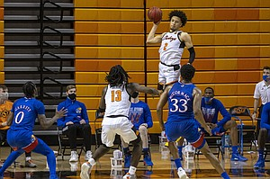 Oklahoma State's Cade Cunningham (2) passes the ball during the second half of the NCAA college basketball game against Kansas in Stillwater, Okla., Tuesday, Jan. 12, 2021. (AP Photo/Mitch Alcala)