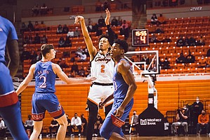 Oklahoma State freshman Cade Cunningham shoots over Christian Braun of Kansas during a college basketball game in Stillwater, Okla., Tuesday, Jan. 12, 2021. Photo by Aaron Hester.