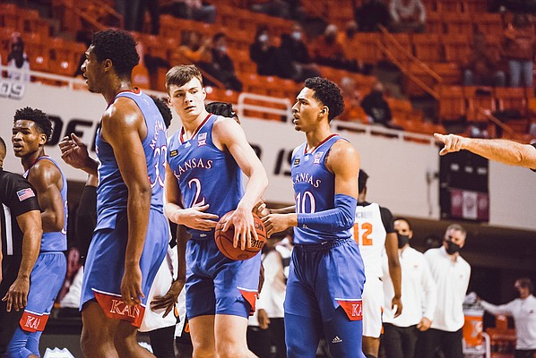 Members of the Kansas men's basketball team make their way to the bench during a college basketball game in Stillwater, Okla., Tuesday, Jan. 12, 2021. Photo by Aaron Hester.