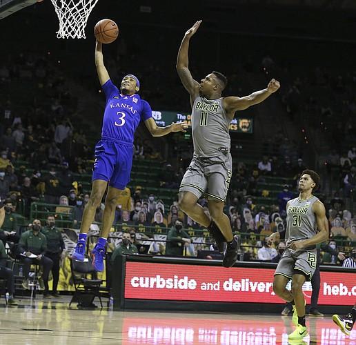 Baylor guard Mark Vital pressures the shot of Kansas guard Dajuan Harris, left, in the first half of an NCAA college basketball game, Monday, Jan. 18, 2021, in Waco, Texas. (Rod Aydelotte/Waco Tribune-Herald via AP)