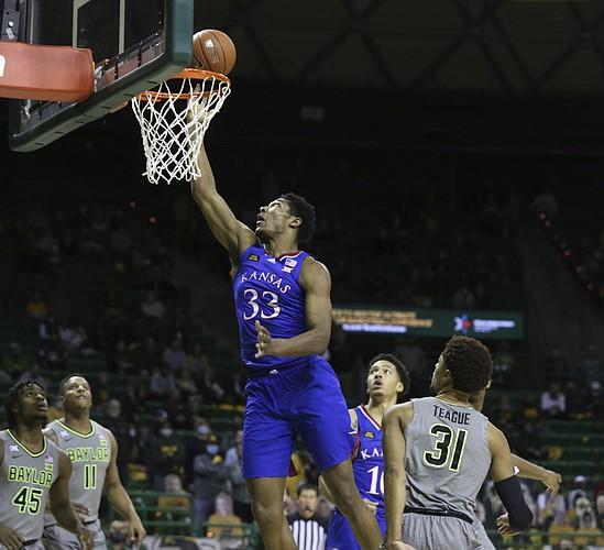Kansas forward David McCormack scores past Baylor guard MaCio Teague, right, in the first half of an NCAA college basketball game, Monday, Jan. 18, 2021, in Waco, Texas. (Rod Aydelotte/Waco Tribune-Herald via AP)