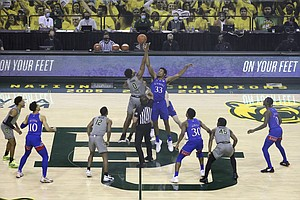 Baylor forward Flo Thamba (0) and Kansas forward David McCormack (33) reach for the tip off in the first half of an NCAA college basketball game, Monday, Jan. 18, 2021, in Waco, Texas. (AP Photo/Jerry Larson)