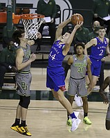 Kansas forward Mitch Lightfoot (44) scores over Baylor guard Matthew Mayer (24) in the first half of an NCAA college basketball game, Monday, Jan. 18, 2021, in Waco, Texas. (AP Photo/Jerry Larson)