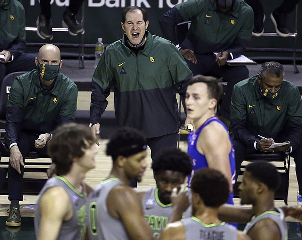 Baylor head coach Scott Drew, top center, reacts to a play in the second half of an NCAA college basketball game against Kansas, Monday, Jan. 18, 2021, in Waco, Texas. (AP Photo/Jerry Larson)