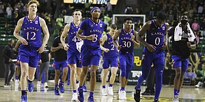 Kansas players leave the court following their loss to Baylor at the Ferrell Center after an NCAA college basketball game, Monday, Jan. 18, 2021, in Waco, Texas. (Rod Aydelotte/Waco Tribune Herald via AP) )