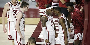 Oklahoma players react during the second half of an NCAA college basketball game against Kansas in Norman, Okla., Saturday, Jan. 23, 2021. (AP Photo/Garett Fisbeck)