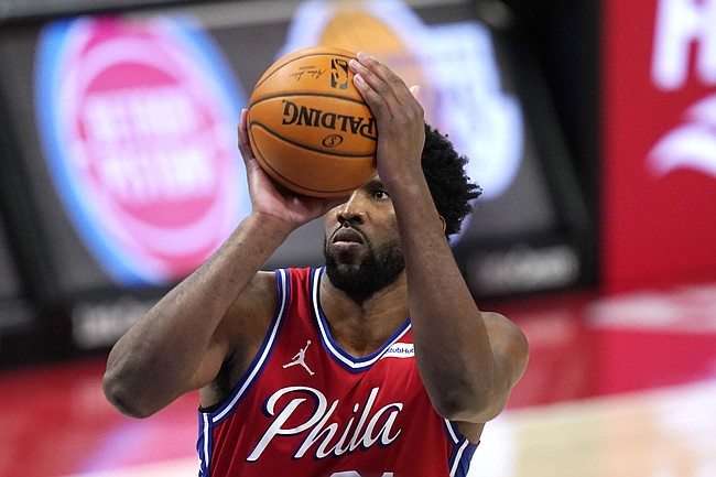 Philadelphia 76ers center Joel Embiid shoots during the second half of an NBA basketball game against the Detroit Pistons, Saturday, Jan. 23, 2021, in Detroit. (AP Photo/Carlos Osorio)