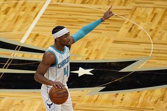 Charlotte Hornets guard Devonte' Graham calls a play to teammates during the first half of an NBA basketball game against the Orlando Magic, Sunday, Jan. 24, 2021, in Orlando, Fla. (AP Photo/John Raoux)
