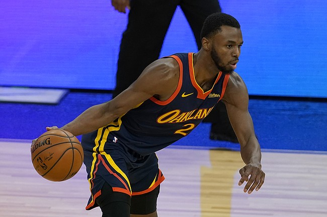 Golden State Warriors forward Andrew Wiggins dribbles against the Minnesota Timberwolves during the second half of an NBA basketball game in San Francisco, Monday, Jan. 25, 2021. (AP Photo/Jeff Chiu)