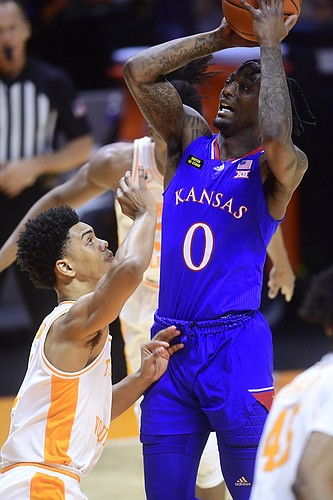 Kansas guard Marcus Garrett (0) shoots as Tennessee guard Jaden Springer (11) defends during a basketball game between the Tennessee Volunteers and the Kansas Jayhawks at Thompson-Boling Arena in Knoxville, Tennessee on Saturday, January 30, 2021.