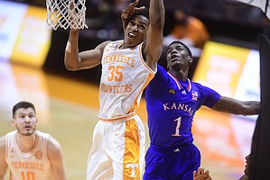 Tennessee guard/forward Yves Pons (35) and Kansas guard Tyon Grant-Foster (1) go for the rebound ball during a basketball game between the Tennessee Volunteers and the Kansas Jayhawks at Thompson-Boling Arena in Knoxville, Tennessee on Saturday, January 30, 2021.