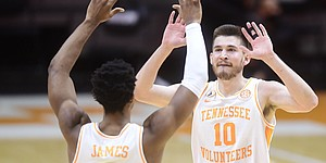 Tennessee guard Josiah-Jordan James (5) and Tennessee forward John Fulkerson (10) celebrate a play during a basketball game between the Tennessee Volunteers and the Kansas Jayhawks at Thompson-Boling Arena in Knoxville, Tennessee on Saturday, January 30, 2021.