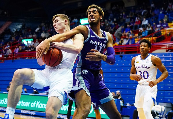Kansas guard Christian Braun (2) pulls a rebound away from Kansas State forward Antonio Gordon (11) during the first half on Tuesday, Feb. 2, 2021 at Allen Fieldhouse.