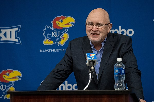 Kansas football offensive coordinator and quarterbacks coach Mike DeBord answers questions during his introductory press conference on Feb. 3, 2021.