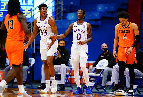 Kansas forward David McCormack (33) erupts after being called for a foul as Kansas guard Marcus Garrett (0) tries to settle him down during the second half on Monday, Feb. 8, 2021 at Allen Fieldhouse.