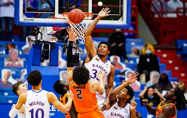 Kansas forward David McCormack (33) elevates to defend against a shot from Oklahoma State guard Cade Cunningham (2) during the second half on Monday, Feb. 8, 2021 at Allen Fieldhouse.