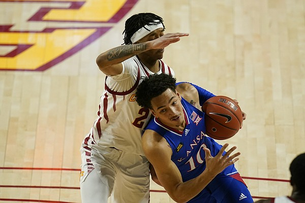 Kansas forward Jalen Wilson (10) drives past Iowa State guard Jaden Walker, left, during the first half of an NCAA college basketball game, Saturday, Feb. 13, 2021, in Ames, Iowa. (AP Photo/Charlie Neibergall)